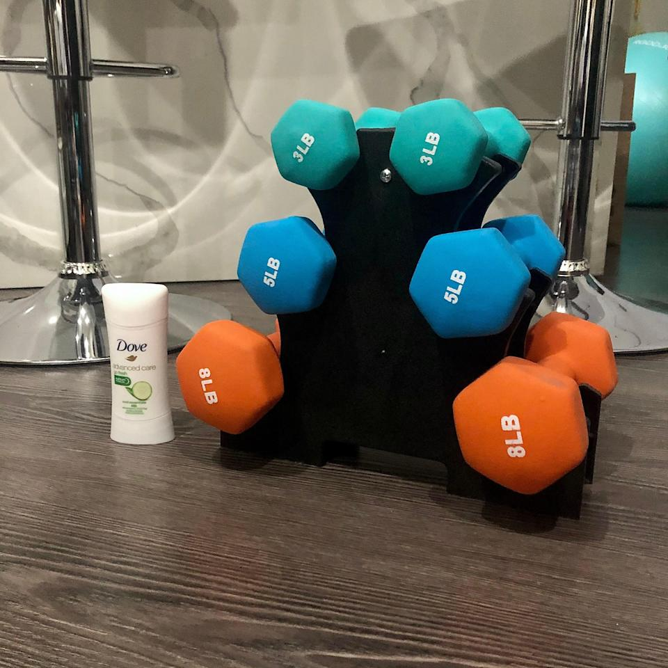 """<h2>Amazon Basics Neoprene-Coated Dumbell Hand Weight Set</h2><br>""""Please behold the luxurious weight room in my studio apartment (jk, but I love this thing). I placed the stick of deodorant in the photo for scale because the size of this mini rack is its best selling. This 32-pound rack comes in handy in every single one of my online workout classes and when I'm done, I just slide it under my bed or in the corner of my non-existent living room. It's specifically my MVP for January because I've been taking Obé classes 3 to 4 times a week and I'm making it a point to do exactly what the instructor recommends every time. I would definitely buy if you exercise in your room and want to add a little extra oomph to your workouts!"""" <em>– Alexandra Polk, Deals Writer</em><br><br><em>Shop <strong><a href=""""https://amzn.to/2LhG9xV"""" rel=""""nofollow noopener"""" target=""""_blank"""" data-ylk=""""slk:Amazon"""" class=""""link rapid-noclick-resp"""">Amazon</a></strong></em><br><br><strong>Amazon Basics</strong> Neoprene Coated Dumbbell Hand Weight Set, $, available at <a href=""""https://amzn.to/3rmS4Kc"""" rel=""""nofollow noopener"""" target=""""_blank"""" data-ylk=""""slk:Amazon"""" class=""""link rapid-noclick-resp"""">Amazon</a>"""