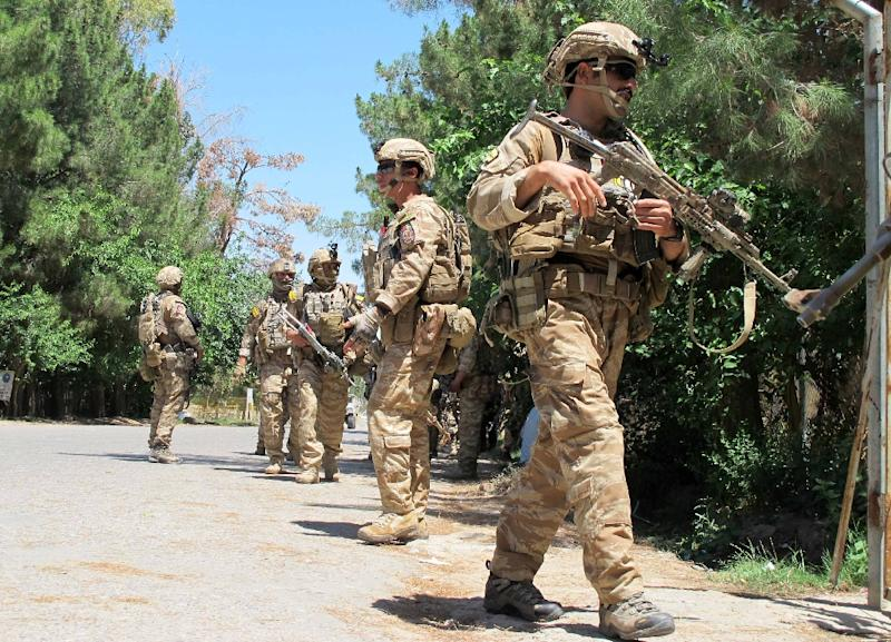 Afghan soldiers walk at the scene of clashes between Afghan security forces and Taliban militants in Helmand province on May 13, 2015 (AFP Photo/Noor Mohammad)