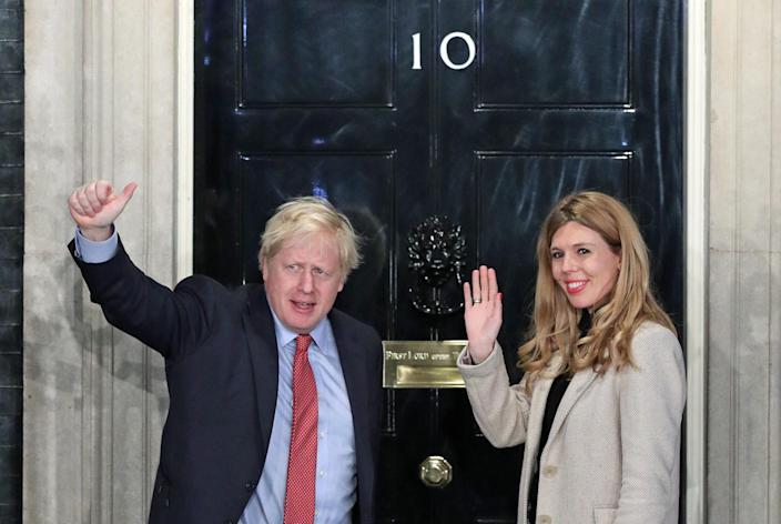 Prime minister Boris Johnson and his girlfriend Carrie Symonds, outside Downing St in December. (PA)