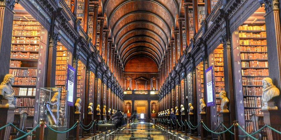 """<p>Modeled after the grand collegiate universities of Oxford and Cambridge, Trinity College was founded in 1592 and is one of the seven ancient universities of Britain and Ireland. The college features 25 different schools, so it makes sense that The Library of Trinity College holds more than 6.2 million printed volumes of manuscripts, maps and music. </p><p><em>photo: </em><a href=""""https://www.flickr.com/creativecommons/"""" rel=""""nofollow noopener"""" target=""""_blank"""" data-ylk=""""slk:Flickr Creative Commons"""" class=""""link rapid-noclick-resp""""><em>Flickr Creative Commons</em></a><br></p>"""