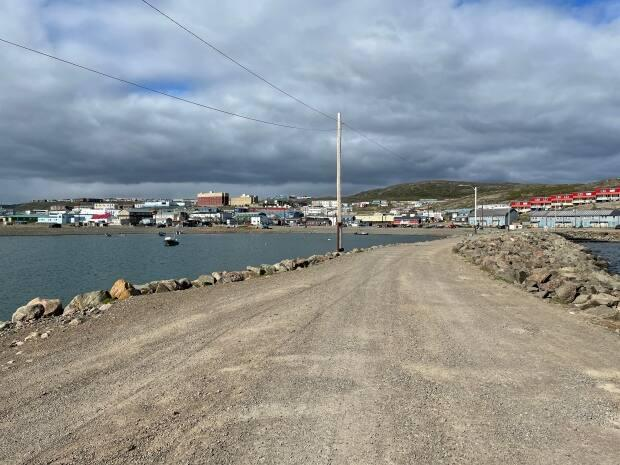 A view of Iqaluit from the breakwater in July of 2021. Traveling out of and back to Nunavut just got a lot easier for parents in the territory. Their children will now be able to self-isolate at home, and vaccinated parents will not have to isolate with them.  (David Gunn/CBC - image credit)