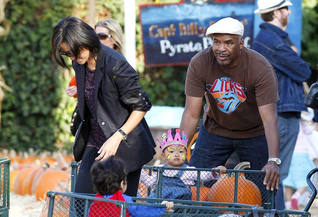 """Actor/comedian David Alan Grier and wife Christine Kim took their daughter, Luisa, for a ride in a pumpkin cart. Jean Baptiste Lacroix/<a href=""""http://www.wireimage.com"""" target=""""new"""">WireImage.com</a> - October 10, 2009"""