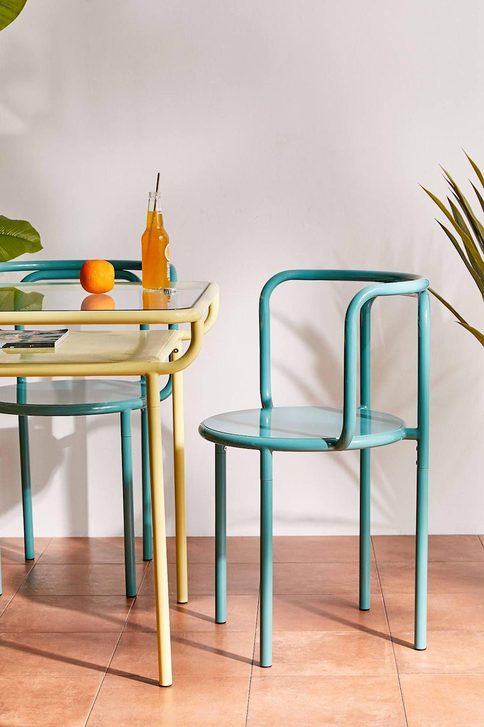 """<p><strong>Urban Outfitters</strong></p><p>urbanoutfitters.com</p><p><strong>$139.00</strong></p><p><a href=""""https://go.redirectingat.com?id=74968X1596630&url=https%3A%2F%2Fwww.urbanoutfitters.com%2Fshop%2Frhys-outdoor-dining-chair&sref=https%3A%2F%2Fwww.goodhousekeeping.com%2Fhome-products%2Fg32743125%2Fbest-patio-chairs%2F"""" rel=""""nofollow noopener"""" target=""""_blank"""" data-ylk=""""slk:Shop Now"""" class=""""link rapid-noclick-resp"""">Shop Now</a></p><p>Count on this sturdy metal patio chair to withstand the elements <em>and</em> add a bold touch to your space. </p>"""