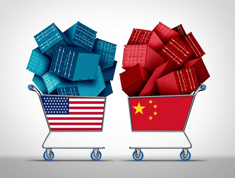Shopping carts filled with miniature shipping containers and marked with U.S. and Chinese flags.