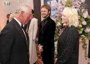 Britain's Prince Charles, left, speaks with performers Finneas O'Connell and Billie Eilish upon arrival for the World premiere of the new film from the James Bond franchise 'No Time To Die', in London, Tuesday, Sept. 28, 2021. (Chris Jackson/Pool Photo via AP)