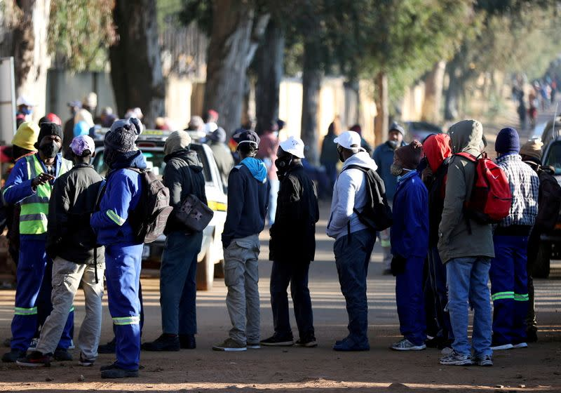 FILE PHOTO: Job seekers stand outside a construction site in Eikenhof, south of Johannesburg,