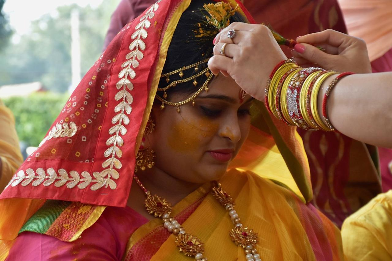 """<p>When a traditional Hindu bride gets married, she uses a turmeric paste on her face and hands in what's known as a Haldi ceremony. It's a symbolic gesture—the color of turmeric resembles that of the planet Jupiter, which astrologically represents prosperity and success. """"By using masks with turmeric, the belief is that you're attracting the planet's energy,"""" says Flor. She adds that many women there also believe turmeric has bonus properties: Glowing skin. <br></p><p><a class=""""body-btn-link"""" href=""""https://go.redirectingat.com?id=74968X1596630&url=https%3A%2F%2Fwww.net-a-porter.com%2Fus%2Fen%2Fproduct%2F1106269&sref=http%3A%2F%2Fwww.oprahmag.com%2Fbeauty%2Fg23454091%2Fbeauty-secrets-around-the-world%2F"""" target=""""_blank"""">Shop Now</a></p>"""