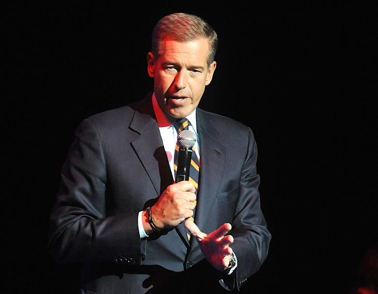 FILE - In this Nov. 5, 2014, file photo, Brian Williams speaks at the 8th Annual Stand Up For Heroes, presented by New York Comedy Festival and The Bob Woodruff Foundation in New York. NBC News gave Williams a second chance after he was caught lying about his role in stories, while Billy Bush apparently won't get the same opportunity following his profane 2005 conversation with Donald Trump. The mistakes of Williams and Bush were different, but in both cases NBC executives needed to weigh whether it was worth rehabilitating them. (Photo by Brad Barket/Invision/AP, File)