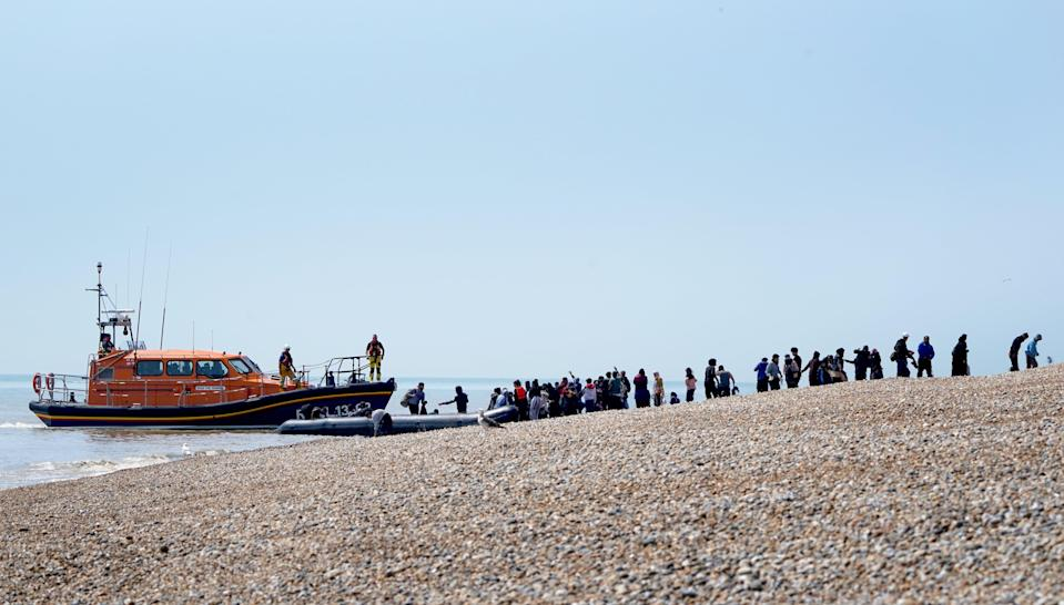 People though to be migrants are watched over by the RNLI (Gareth Fuller/PA) (PA Wire)