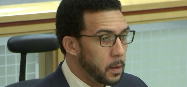Kellen Winslow sits in court, awaiting the judge's decision to declare a mistrial on the remaining counts. (CourtTV)