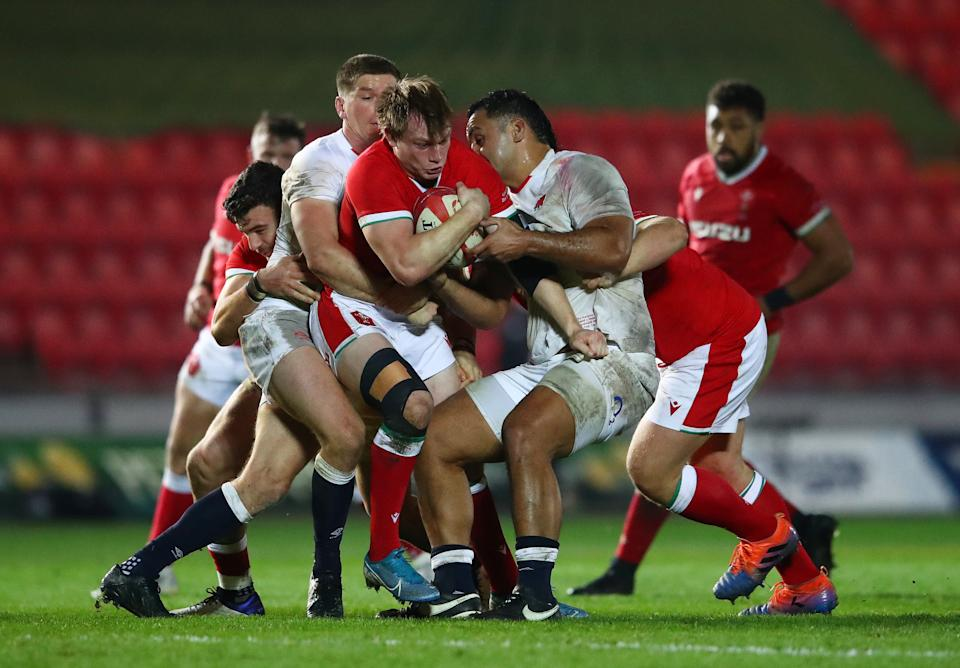 Nick Tompkins (centre) in action for Wales against EnglandGetty Images