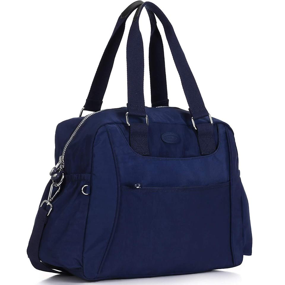 """<h2>Lily & Drew Nylon Travel Tote</h2><br><strong>The Type: </strong>Carry-on tote<br><br><strong>The Hype:</strong> 4.6 out of 5 stars and 1,270 reviews on Amazon<br><br><strong>What Travelers Say: </strong>""""Fantastic personal item for plane travel. Great inner and outer compartments, and good capacity for everything I like to keep easily accessible while traveling, plus an emergency change of clothes in case I have to gate check and my carryon gets lost."""" – <em>J. Harbour, Amazon Reviewer</em><br><br><em>Shop</em> <strong><em><a href=""""https://amzn.to/3wdrOV0"""" rel=""""nofollow noopener"""" target=""""_blank"""" data-ylk=""""slk:Lily & Drew"""" class=""""link rapid-noclick-resp"""">Lily & Drew</a></em></strong><br><br><strong>Lily & Drew</strong> Nylon Travel Tote, $, available at <a href=""""https://amzn.to/2NFpXFj"""" rel=""""nofollow noopener"""" target=""""_blank"""" data-ylk=""""slk:Amazon"""" class=""""link rapid-noclick-resp"""">Amazon</a>"""