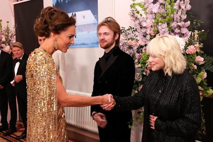 """<div class=""""inline-image__caption""""><p>Britain's Catherine, Duchess of Cambridge (L) meets US singer-songwriter Finneas O'Connell (C) and US singer-songwriter Billie Eilish ahead of the World Premiere of the James Bond 007 film """"No Time to Die"""" at the Royal Albert Hall in west London on September 28, 2021.</p></div> <div class=""""inline-image__credit"""">CHRIS JACKSON/POOL/AFP via Getty Images</div>"""