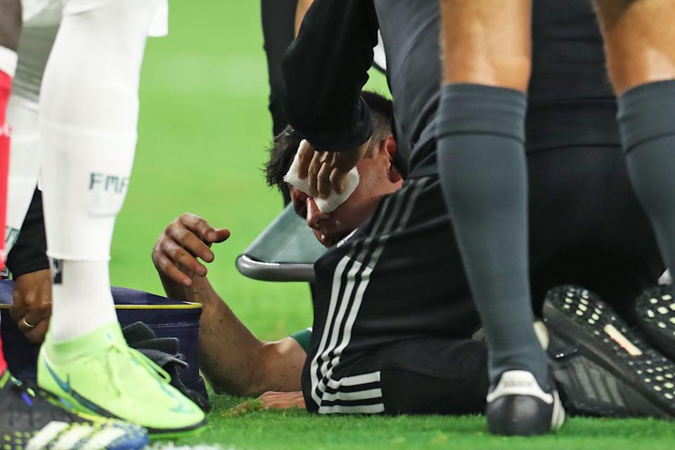 ARLINGTON, TX - JULY 10: Hirving Lozano #22 of Mexico is injured during the match of CONCACAF Gold Cup Group A between Mexico and Trinidad & Tobago at AT&T Stadium on July 10, 2021 in Arlington, Texas. (Photo by Omar Vega/Getty Images)