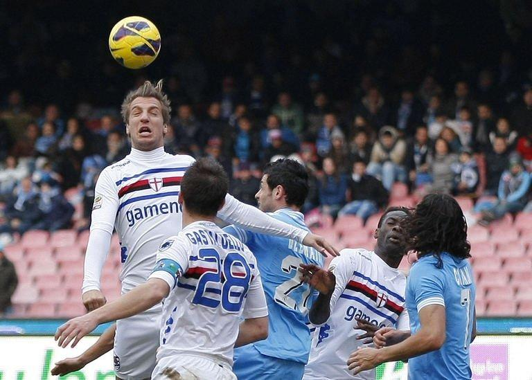 Sampdoria forward Maxi Lopez (L) heads the ball during the match against Napoli in Naples on February 17, 2013