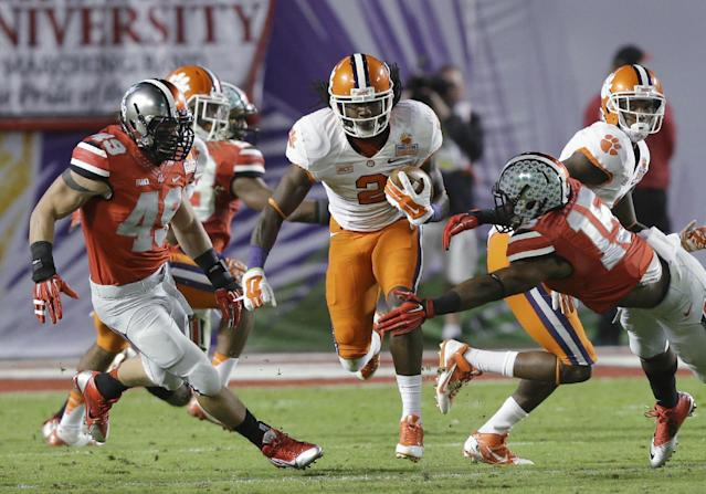 Clemson wide receiver Sammy Watkins (2) runs between Ohio State defenders during the first half of the Orange Bowl NCAA college football game, Friday, Jan. 3, 2014, in Miami Gardens, Fla. (AP Photo/Wilfredo Lee)