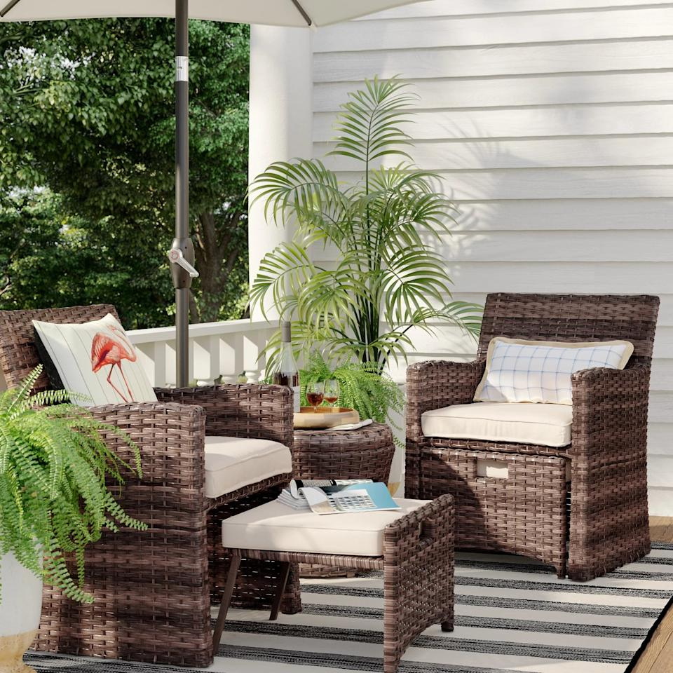 """<p>The <a href=""""https://www.popsugar.com/buy/Halsted-Wicker-Small-Space-Patio-Furniture-Set-446211?p_name=Halsted%20Wicker%20Small%20Space%20Patio%20Furniture%20Set&retailer=target.com&pid=446211&price=495&evar1=casa%3Aus&evar9=46067166&evar98=https%3A%2F%2Fwww.popsugar.com%2Fphoto-gallery%2F46067166%2Fimage%2F47541674%2FHalsted-Wicker-Small-Space-Patio-Furniture-Set&list1=shopping%2Cfurniture%2Csummer%2Coutdoor%20decorating&prop13=api&pdata=1"""" rel=""""nofollow"""" data-shoppable-link=""""1"""" target=""""_blank"""" class=""""ga-track"""" data-ga-category=""""Related"""" data-ga-label=""""https://www.target.com/p/halsted-5pc-wicker-small-space-patio-furniture-set-threshold-153/-/A-54283768?preselect=51268316#lnk=sametab"""" data-ga-action=""""In-Line Links"""">Halsted Wicker Small Space Patio Furniture Set </a> ($495, originally $550) is so warm and inviting, you'll want to stay up and chat the night away.</p>"""