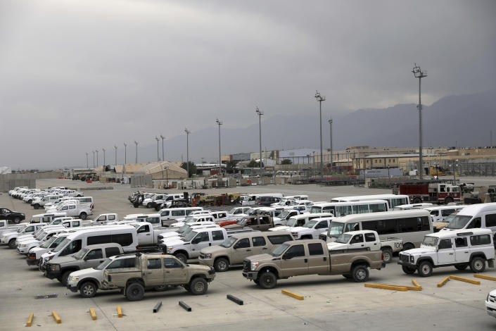 FILE - In this July 5, 2021 file photo, vehicles are parked at Bagram Airfield after the American military left the base, in Parwan province north of Kabul, Afghanistan. The US and NATO have promised to pay $4 billion a year until 2024 to finance Afghanistan's military and security forces, which are struggling to contain an advancing Taliban. Already since 2001, the U.S. has spent nearly $89 billion to build, equip and train the forces, including nearly $10 billion for vehicles and aircraft. (AP Photo/Rahmat Gul, File)