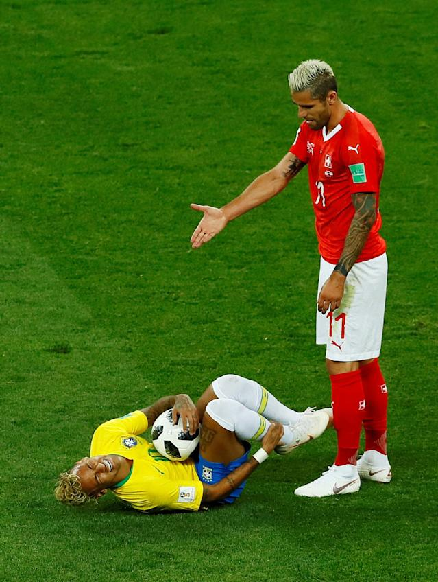 Soccer Football - World Cup - Group E - Brazil vs Switzerland - Rostov Arena, Rostov-on-Don, Russia - June 17, 2018 Switzerland's Valon Behrami gestures next to Brazil's Neymar REUTERS/Jason Cairnduff TPX IMAGES OF THE DAY