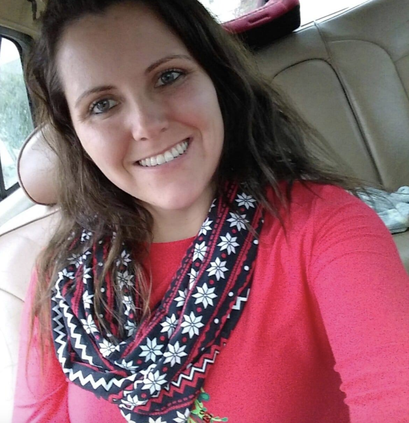 Photo shows Natalie Jones sitting in a car smiling.