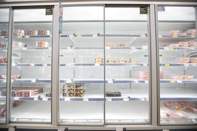 Empty shelves are seen in the meat aisle of Co-Op supermarket, Harpenden