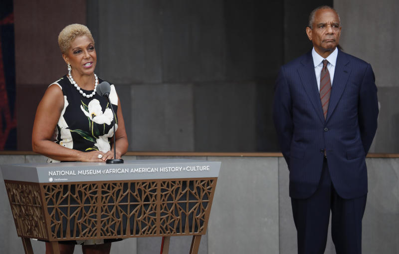 FILE - In this Sept. 24, 2016 file photo Linda Johnson Rice, left, Chairman, Johnson Publishing Company, Inc., and Publisher of Ebony and Jet magazines, is joined by Kenneth Irvine Chenault, right, CEO and Chairman of American Express, at the dedication ceremony for the Smithsonian Museum of African American History and Culture on the National Mall in Washington. The new owners of the Ebony and Jet photo archive, Darren Walker as president of the Ford Foundation and Elizabeth Alexander, president of the Andrew W. Mellon Foundation, promised on Thursday, July 25, 2019, to donate the more than 4 million prints and negatives from the iconic black magazines to the Smithsonian National Museum of African American History and Culture and the Getty Research Institute.  (AP Photo/Pablo Martinez Monsivais, File)