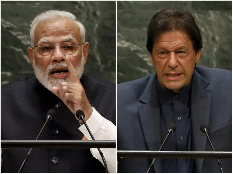 In this combination photo, India's Prime Minister Narendra Modi, left, and Pakistan's Prime Minister Imran Khan address the 74th session of the United Nations General Assembly, Friday, Sept. 27, 2019. (AP Photo/Richard Drew)