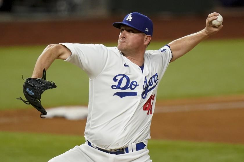 Los Angeles Dodgers relief pitcher Jake McGee throws against the Atlanta Braves during the sixth inning in Game 2 of a baseball National League Championship Series Tuesday, Oct. 13, 2020, in Arlington, Texas. (AP Photo/Eric Gay)