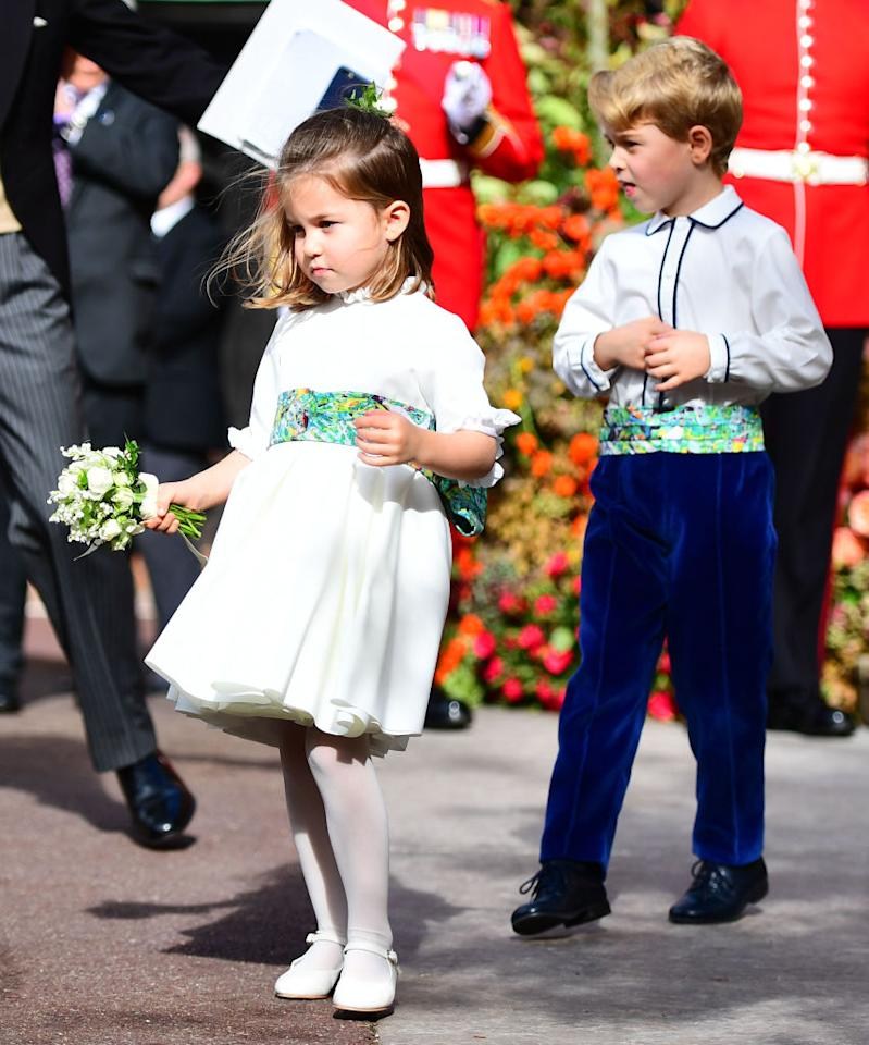 <p>Prince George and Princess Charlotte took on the roles of page boy and bridesmaid once again for Princess Eugenie and Jack Brooksbank's wedding on October 12. They both wore outfits designed by Amaia Arrieta of Amaia Kids with sashes to reflect the artwork of Mark Bradford. <em>[Photo: Getty]</em> </p>