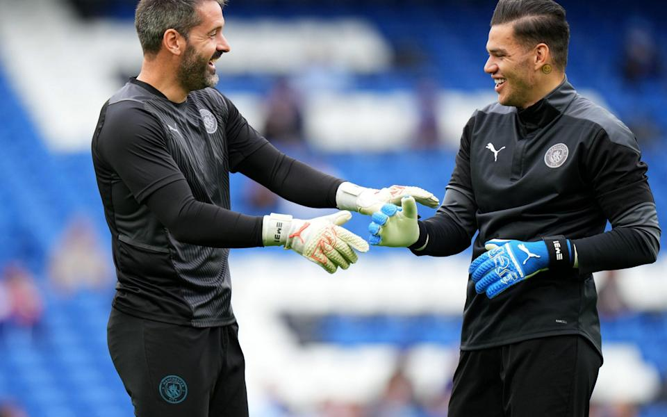 Scott Carson of Manchester City interacts with Ederson - Matt McNulty - Manchester City/Manchester City FC via Getty Images