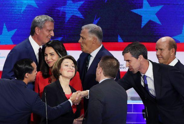 PHOTO: Chuck Todd of NBC News greets Sen. Amy Klobuchar, former housing secretary Julian Castro, former Texas congressman Beto O'Rourke and other candidates after the first night of the Democratic presidential debate on June 26, 2019, in Miami. (Joe Raedle/Getty Images)