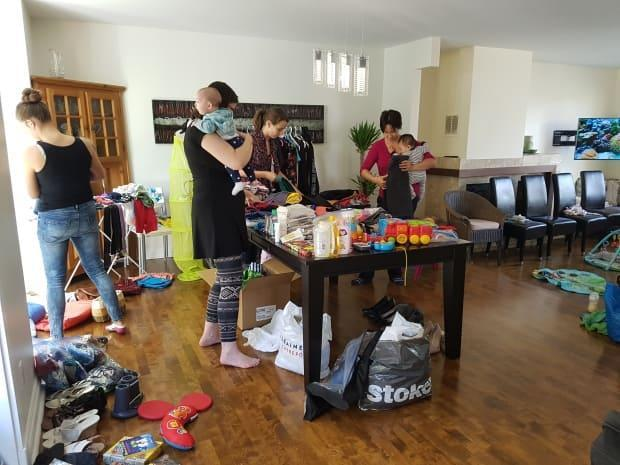 Before the pandemic hit, women on the Social.mom app would use the space to organize events, such as this clothing swap.