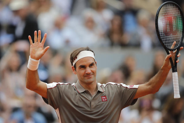 Switzerland's Roger Federer celebrates winning against Italy's Lorenzo Sonego during their first round match of the French Open tennis tournament at the Roland Garros stadium in Paris, Sunday, May 26, 2019. (AP Photo/Michel Euler )