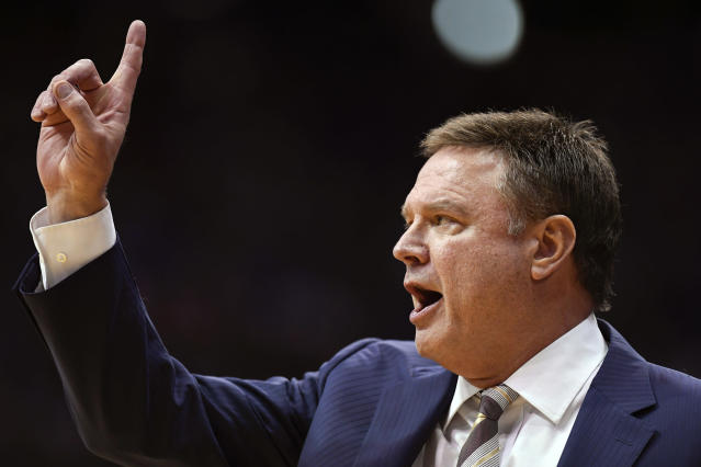 FILE - In this Feb. 3, 2020, file photo, Kansas head coach Bill Self directs his team against Texas during the second half of an NCAA college basketball game in Lawrence, Kan. Kansas finished the season No. 1 in The Associated Press college basketball poll, receiving 63 of 65 first-place votes from a national media panel Wednesday, March 18, 2020. (AP Photo/Reed Hoffmann, File)