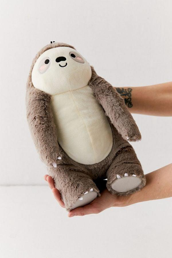 """<p>At over 12"""" in height, the <a href=""""https://www.popsugar.com/buy/Smoko-Toasty-Heatable-Sloth-Plushie-484346?p_name=Smoko%20Toasty%20Heatable%20Sloth%20Plushie&retailer=urbanoutfitters.com&pid=484346&price=29&evar1=savvy%3Aus&evar9=46546421&evar98=https%3A%2F%2Fwww.popsugar.com%2Fsmart-living%2Fphoto-gallery%2F46546421%2Fimage%2F46546816%2FSmoko-Toasty-Heatable-Plushie&list1=pillows%2Curban%20outfitters%2Csloth&prop13=mobile&pdata=1"""" rel=""""nofollow"""" data-shoppable-link=""""1"""" target=""""_blank"""" class=""""ga-track"""" data-ga-category=""""Related"""" data-ga-label=""""http://www.urbanoutfitters.com/shop/smoko-toasty-heatable-plushie?category=party-supplies-games&amp;color=004&amp;quantity=1&amp;size=ONE%20SIZE&amp;type=REGULAR&amp;viewcode=b"""" data-ga-action=""""In-Line Links"""">Smoko Toasty Heatable Sloth Plushie</a> ($29) is the perfect size.</p>"""