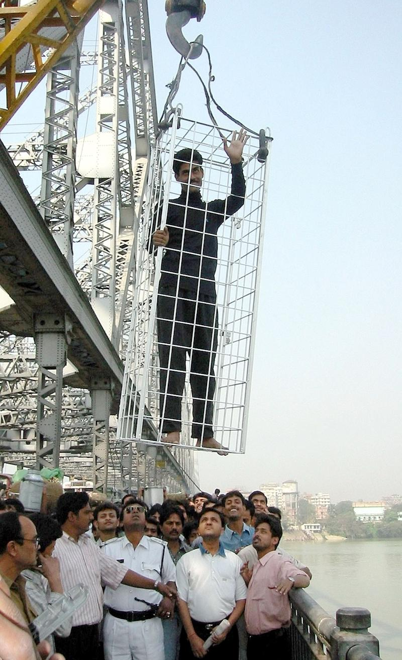 Mr Lahiri waves to the crowd before a previous stunt in the Hooghly river in 2002 (Picture: Reuters)