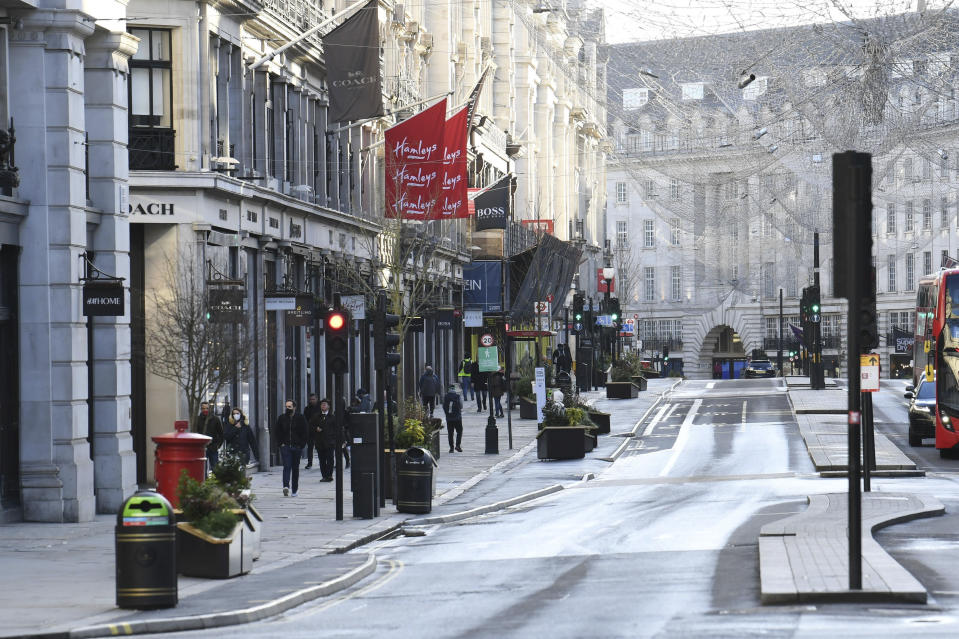 A view of part of Regent Street after Britian's Prime Ministr Boris Johnson introduced Tier 4 restrictions for London and the south east of the country, in London, Sunday, Dec. 20, 2020. Millions of people in England have learned they must cancel their Christmas get-togethers and holiday shopping trips. British Prime Minister Boris Johnson said Saturday that holiday gatherings can't go ahead and non-essential shops must close in London and much of southern England. Johnson imposed a new, higher level of coronavirus restrictions to curb sharply spreading infections in the capital and other areas. (Stefan Rousseau/PA via AP)