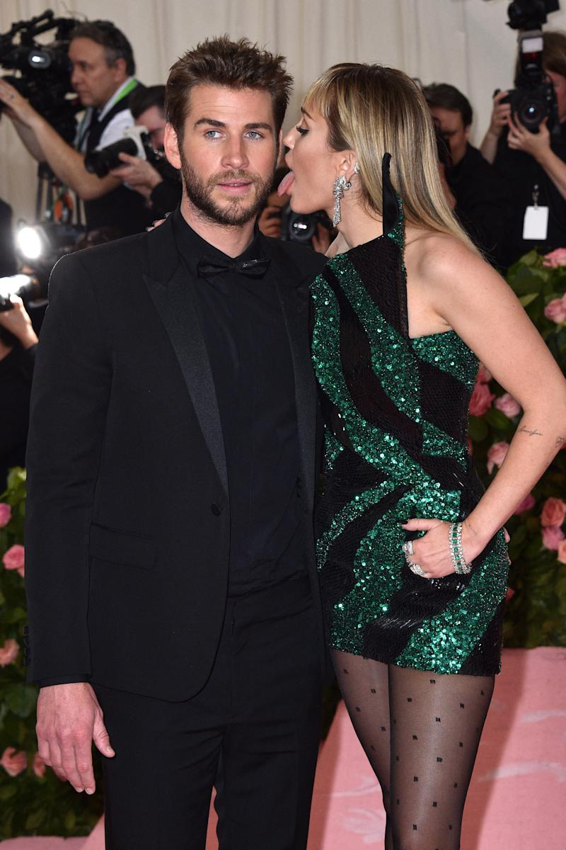 Liam Hemsworth stunned as Miley Cyrus licks his face