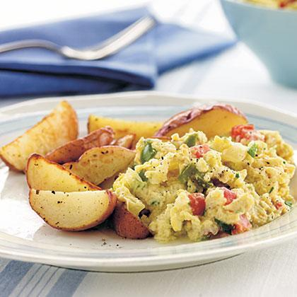 """<p>Bring garden freshness to your table with these veggie-laden scrambled eggs. Red tomato, juicy onion, and <a href=""""https://www.myrecipes.com/how-to/7-ways-with/ways-to-cook-bell-peppers"""" rel=""""nofollow noopener"""" target=""""_blank"""" data-ylk=""""slk:green bell pepper"""" class=""""link rapid-noclick-resp"""">green bell pepper</a> perk up this traditional breakfast dish.</p>"""