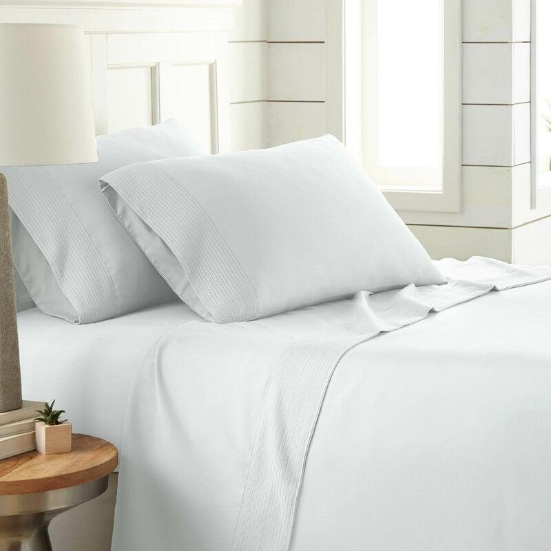 """<h2>48% Off Laural Foundry Eldon Sheet Set</h2><br><strong>4.7 out of 5 stars and 18,861 reviews </strong><br>""""Great sheet set! Fits the bed well and doesn't crawl or slip off! I didn't know if I would like them at first because they seemed a little thin...but I love them! They are so soft and cool! I have washed them now many times and they have held up wonderfully! I would definitely buy them again!"""" <em>– Wayfair Reviewer</em><br><br><em>Shop <strong><a href=""""https://www.wayfair.com/bed-bath/pdp/eldon-sheet-set-lfmf4289.html"""" rel=""""nofollow noopener"""" target=""""_blank"""" data-ylk=""""slk:Wayfair"""" class=""""link rapid-noclick-resp"""">Wayfair</a></strong></em><br><br><strong>Eldon</strong> Eldon Sheet Set, $, available at <a href=""""https://go.skimresources.com/?id=30283X879131&url=https%3A%2F%2Fwww.wayfair.com%2Fbed-bath%2Fpdp%2Feldon-sheet-set-lfmf4291.html"""" rel=""""nofollow noopener"""" target=""""_blank"""" data-ylk=""""slk:Wayfair"""" class=""""link rapid-noclick-resp"""">Wayfair</a>"""