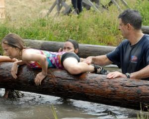 Child on NAVY obstacle course with dad