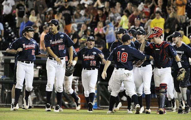 Vanderbilt players celebrate after Vanderbilt defeated Virginia 9-8 in the opening game of the best-of-three NCAA baseball College World Series finals in Omaha, Neb., Monday, June 23, 2014. (AP Photo/Eric Francis)