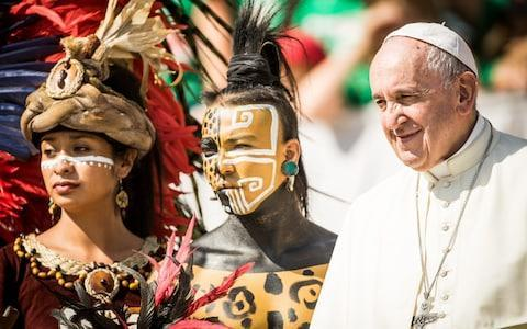 <span>Pope Francis poses with native Mexican people during his weekly audience in St. Peter's Square on August 29, 2018 in the Vatican.</span> <span>Credit: Giulio Origlia/Getty </span>