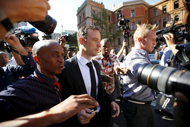 South African Olympic and Paralympic sprinter Oscar Pistorius (C) leaves the North Gauteng High Court in Pretoria after a brief appearance, April 18, 2016. REUTERS/Mike Hutchings