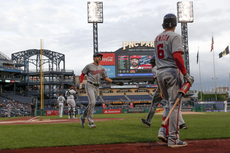Washington Nationals' Adam Eaton, center, scores on a ground ball to third by Howie Kendrick as on-deck batter Anthony Rendon (6) watches in the first inning of a baseball game against the Pittsburgh Pirates, Thursday, Aug. 22, 2019, in Pittsburgh. (AP Photo/Keith Srakocic)