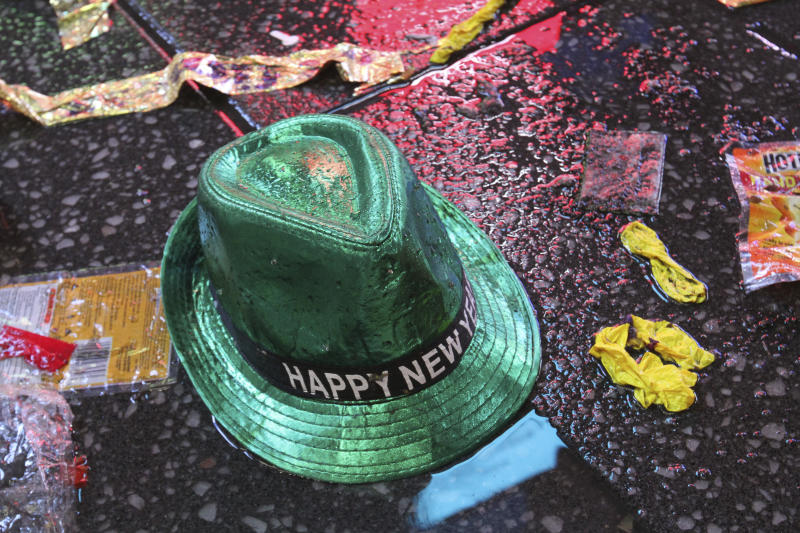 A Happy New Year hat lies on the wet ground along with other items following the celebration in New York's Times Square