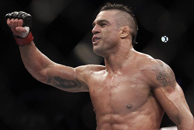 FILE - In this Jan. 20, 2013, file photo, Vitor Belfort, from Brazil, celebrates after defeating Michael Bisping, of Britian, during their middleweight mixed martial arts bout in Sao Paulo, Brazil. Belfort dropped out of his upcoming UFC middleweight title shot on Thursday, Feb. 27, 2014, a few hours after the Nevada Athletic Commission banned testosterone replacement therapy. Belfort was scheduled to fight 185-pound champion Chris Weidman at UFC 173 on May 24. His title shot was given to Lyoto Machida by UFC President Dana White. (AP Photo/Andre Penner, File)