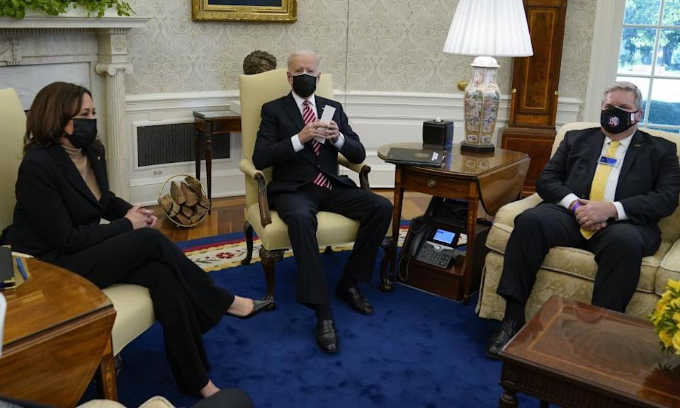 Kamala Harris and Joe Biden meet with labor leaders in the Oval Office of the White House, including Eric Dean, general president of the Ironworkers International Union, right, in February.