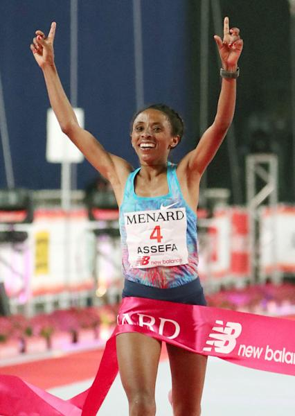 Meskerem Assefa of Ethiopia crosses the finish line, winning Nagoya Women's Marathon in Nagoya, central Japan, Sunday, March 11, 2018. Assefa won with time of 2 hours, 21 minutes and 45 seconds. (Kyodo News via AP)
