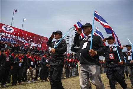 "Members of ""Volunteers' Ward to protect the Nation's Democracy"" group take part during march marking end of two days training at stadium in Nakhon Ratchasima"